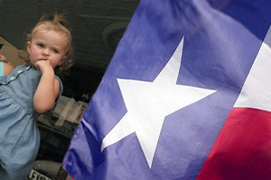 Little Girl Next to Flag